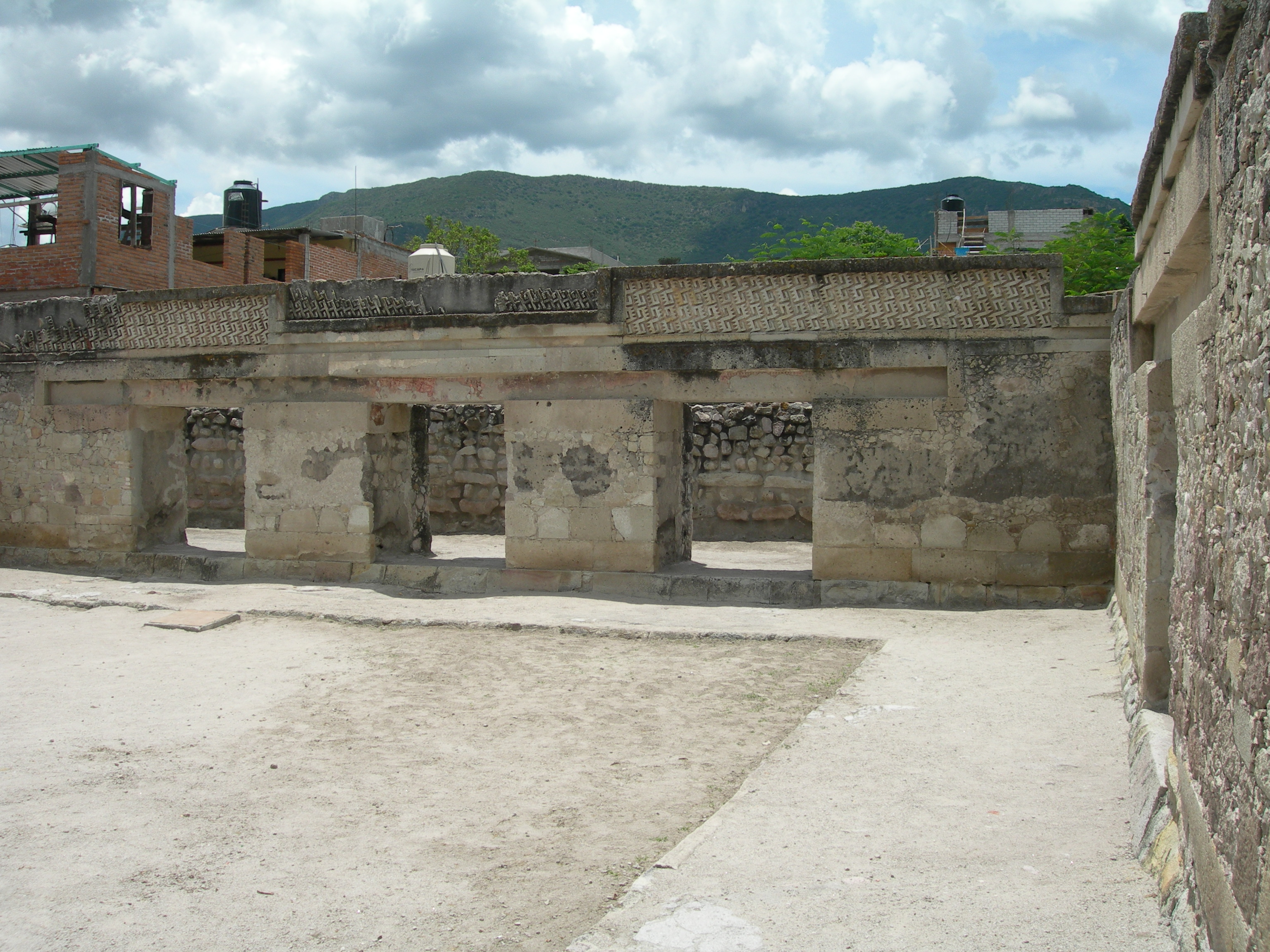 FIGURE 15. One of the palaces in the Church group at Mitla in the Valley of Oaxaca. On the flat indented panel above the doorways you can see the remains of red and white mural paintings. These long narrow bands of flowing images have much in common with the visual layout of an unfolded screenfold book. Photograph by Byron Hamann, June 2011.