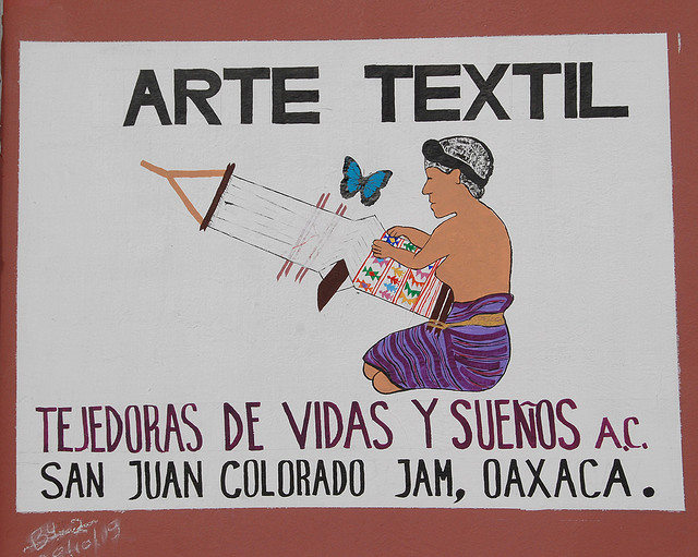 FIGURE 17. Backstrap loom in use, as depicted on a shop sign from San Juan Colorado in the Mixteca de la Costa. Photo by Thomas F. Aleto.